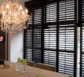 custom dark stained plantation shutters in Texas kitchen